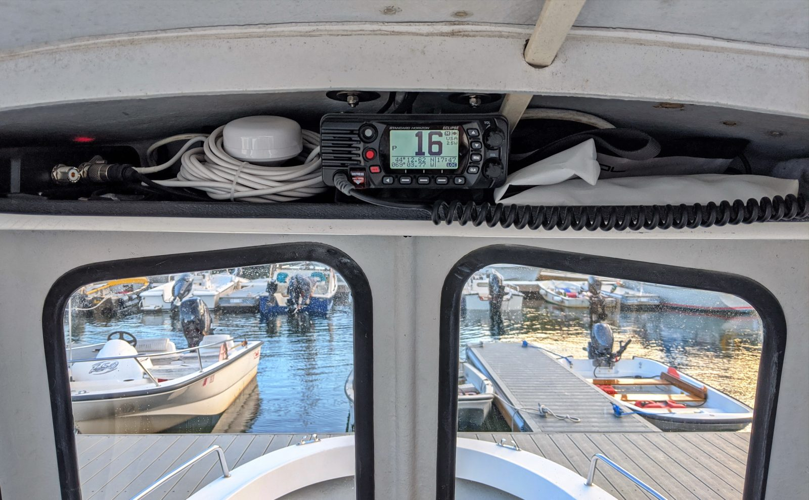 The overhead shelf is stuffed with cables, AIS & VHF for a reason